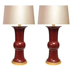 A Pair Of Oxblood Porcelain Lamps
