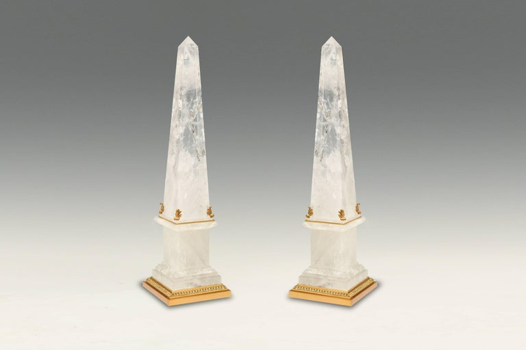 A pair of rock crystal obelisks with fine carved metal decoration, created by Phoenix Gallery, NYC.