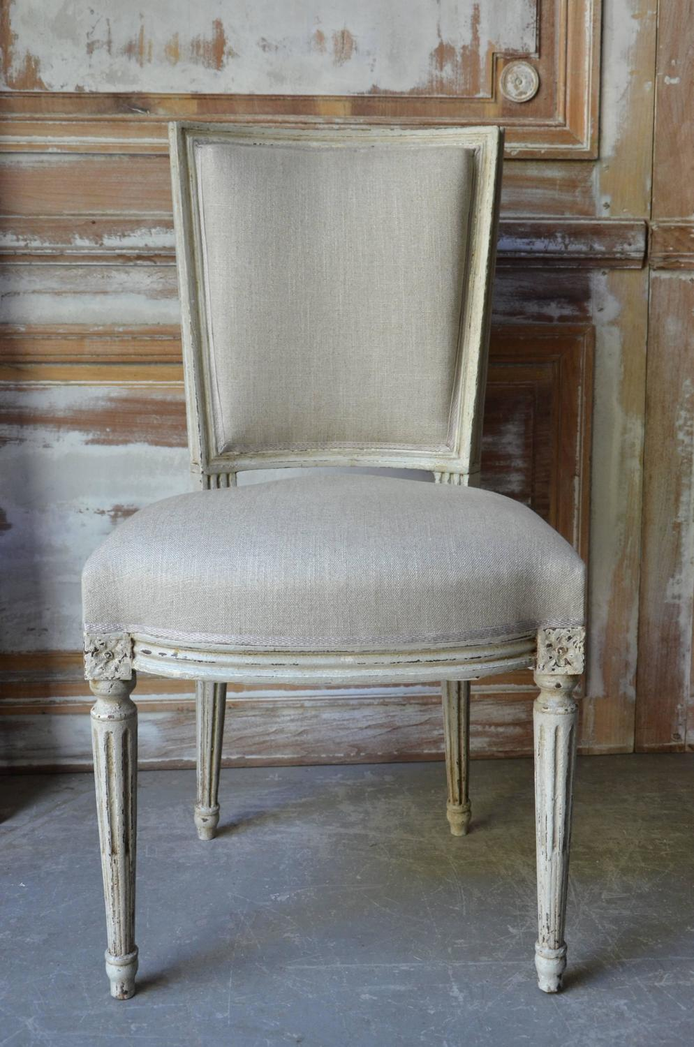 set of eight painted french louis xvi style dining chairs