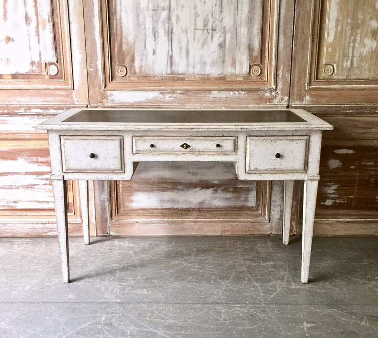 Elegant 19th century French Louis XVI style Bureaux plat with drawers, two extension pull-out surface and leather top with nicely stamped guilt embossing design. The back of the desk with finished solid panel, France, circa 1880. Surprising pieces