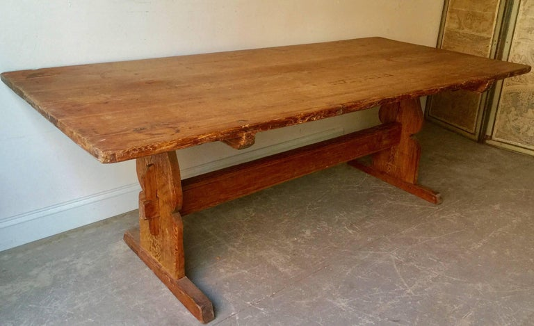 "Large early 19th century, Swedish trestle table in style in ""Allmogestil"" country folk customs and traditions cherished of the native traditions and folk culture. A rustic family table with wonderful old patinated pine and thick, wide board top on"