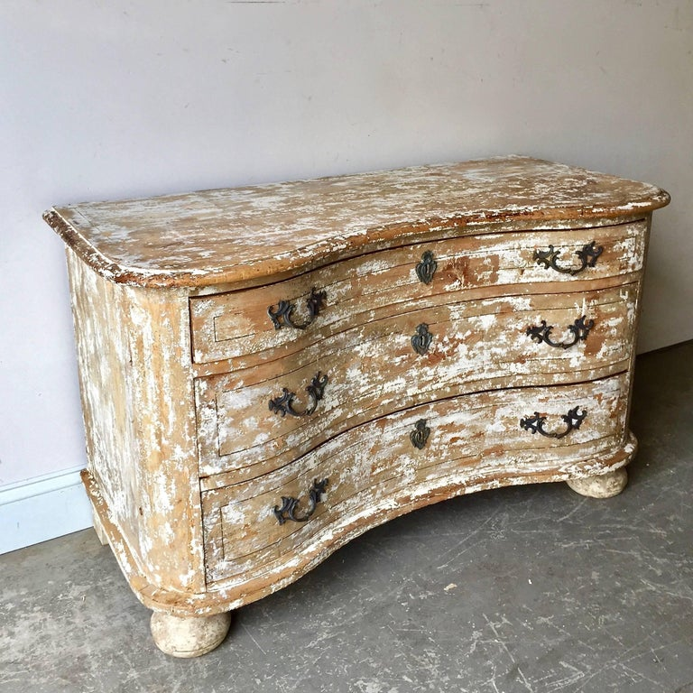 18th century low chest of drawers from late Baroque period in richly carved curvaceous serpentine drawer fronts, with handsome bronze hardwares and shaped top and ball feet ... all in super time worn patina! Alsace, France. Here are few examples …