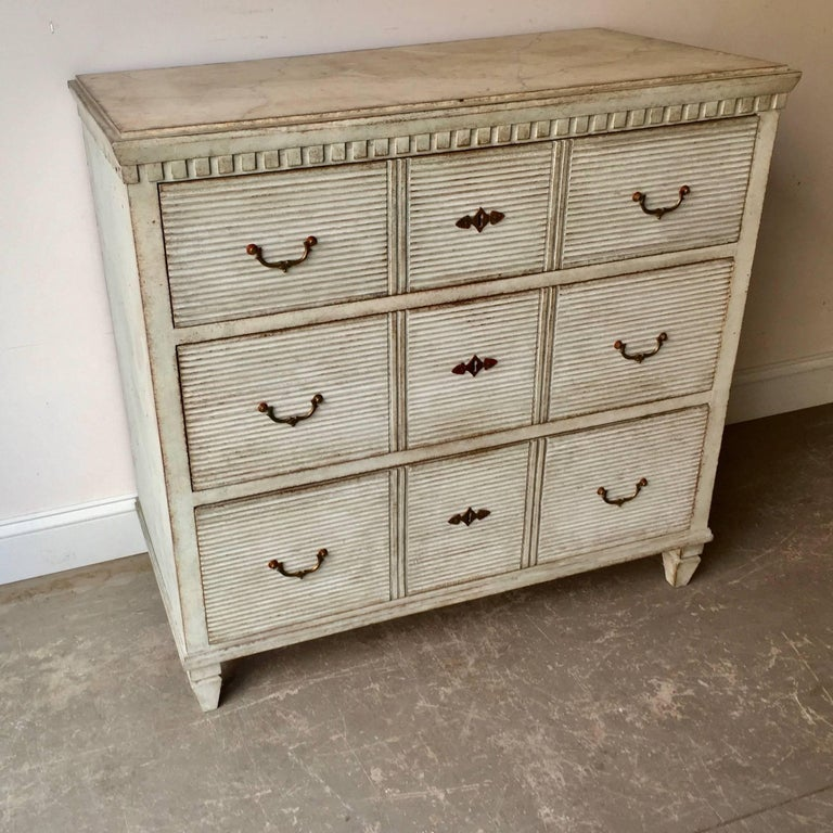 Gustavian Period Chest of drawers, Sweden circa 1810,  with three raised reeded panels on each of its drawer fronts.  Dentil molding under the shaped top . Original brass hardware. Here are few examples … surprising pieces and objects, authentic,