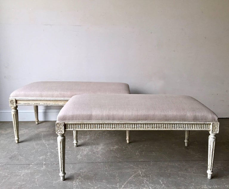 Charming almost  a pair painted benches in Louis XVI style, with legs conical flutings and joining dies decorated with a classical daisy motifs. Upholstered in linen with traditional trimming. Ideal for end of beds or hall way. France circa 1900