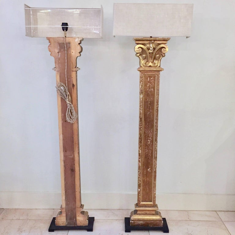 A wonderful Pair of 19th century richly carved pilaster fragment in patinated goldgilt made into floorlamps, mounted on iron base and with custom made linen shades.  France. Lampshade : 20