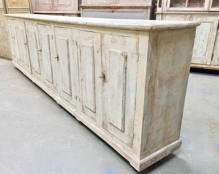 A huge, 8 door 18th century Italian painted sideboard in wonderful time worn patina and able space for storage. Here are few examples … surprising pieces and objects, authentic, decorative and rare items that you will only see in our gallery.