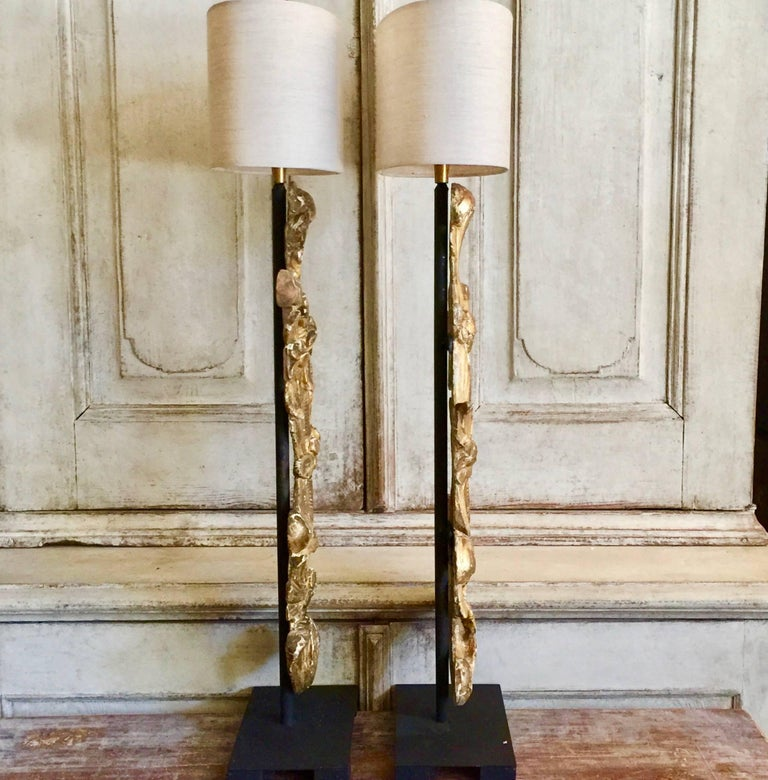 A magnificient highly decorative 19th century gold gilt fragments made into the table lamps, mounted on iron base and with custom made oval linen shades.  France. Shade: 12