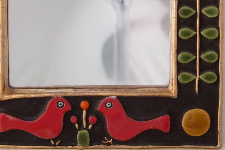Rectangular shaped ceramic mirror with tympanum by Francois Lembo decorated with birds and flowers in multi-colors, France, 1970s.   François Lembo from Vallauris started his pottery career in 1951 in the workshops of Calva and Rossignol. After