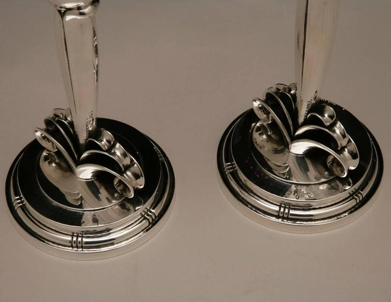Evald Nielsen sterling silver pair of Art Deco candlesticks.  Stunning sterling silver Art Deco pair of candlesticks. Exquisitely hand-wrought mounted on stylized scrolls and stepped base.  Designed in 1920s. Handmade in Denmark at the Evald