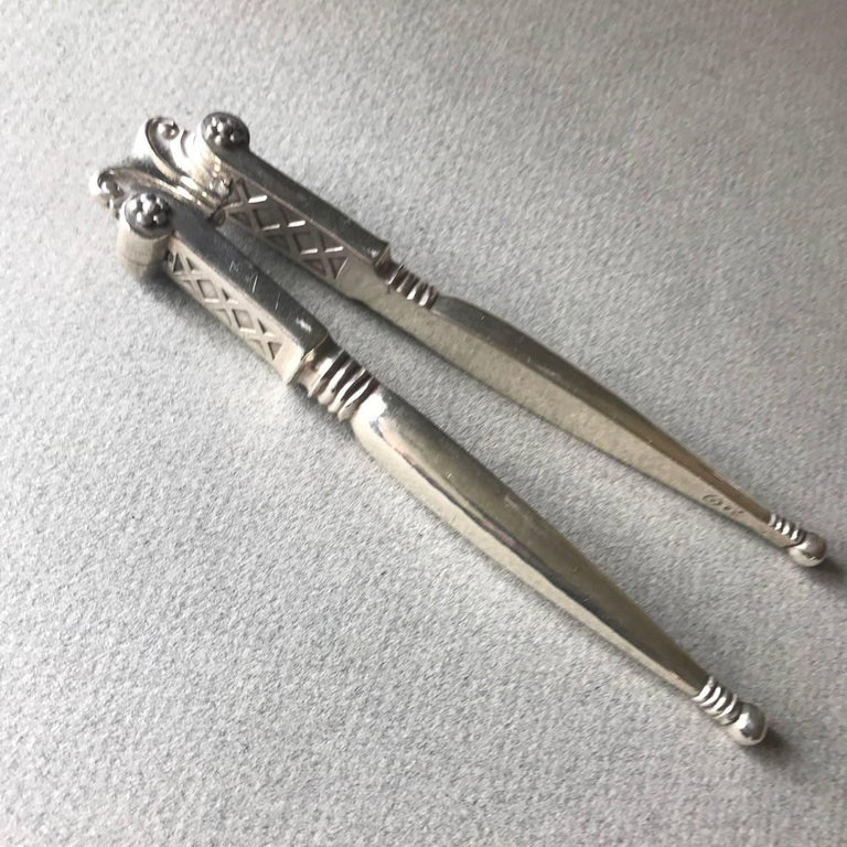 Georg Jensen 830 silver nut crackers no. 134 Can also be used as a Lobster Cracker.  Hand-forged from solid 830 silver. Extremely heavy. Exceptional details. Designed by Johan Rohde,  circa 1919-1927  About the designer: Johan Rohde