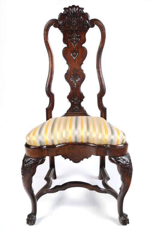 Portuguese Rococo walnut side chair Portugal, circa 1745  Carved walnut  Measures: 45