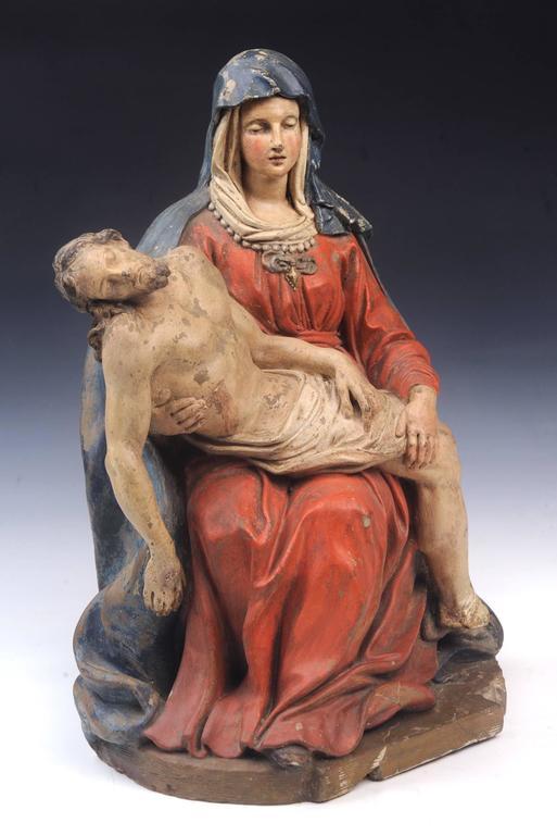 16th century Pieta, of the seated virgin holding the body of the dead Christ, circa 1580 Follower: Jacopo Sansovino (Italian 1486-1570) Polychrome terracotta  Measures: 16