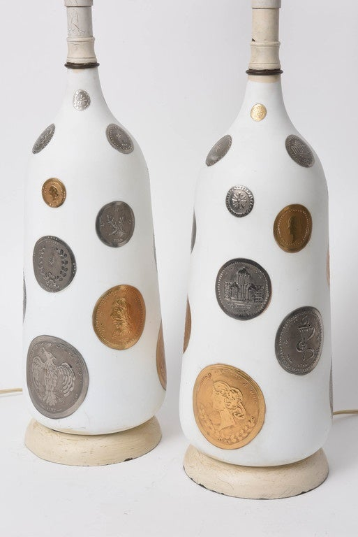 This witty pair of lamps are decorated with hand-painted gold and silver coins on hand-blown white opaque glass.  From the 1960s.