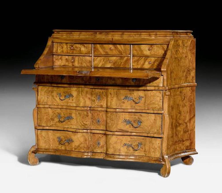 Baroque bureau cabinet or desk,  Baroque, Northern Italy, Lombardy, circa 1720.  Walnut burl wood and fruitwood veneer and inlaid with reserves and fillets. Front with hinged writing surface over four drawers. Inner compartment with six drawers