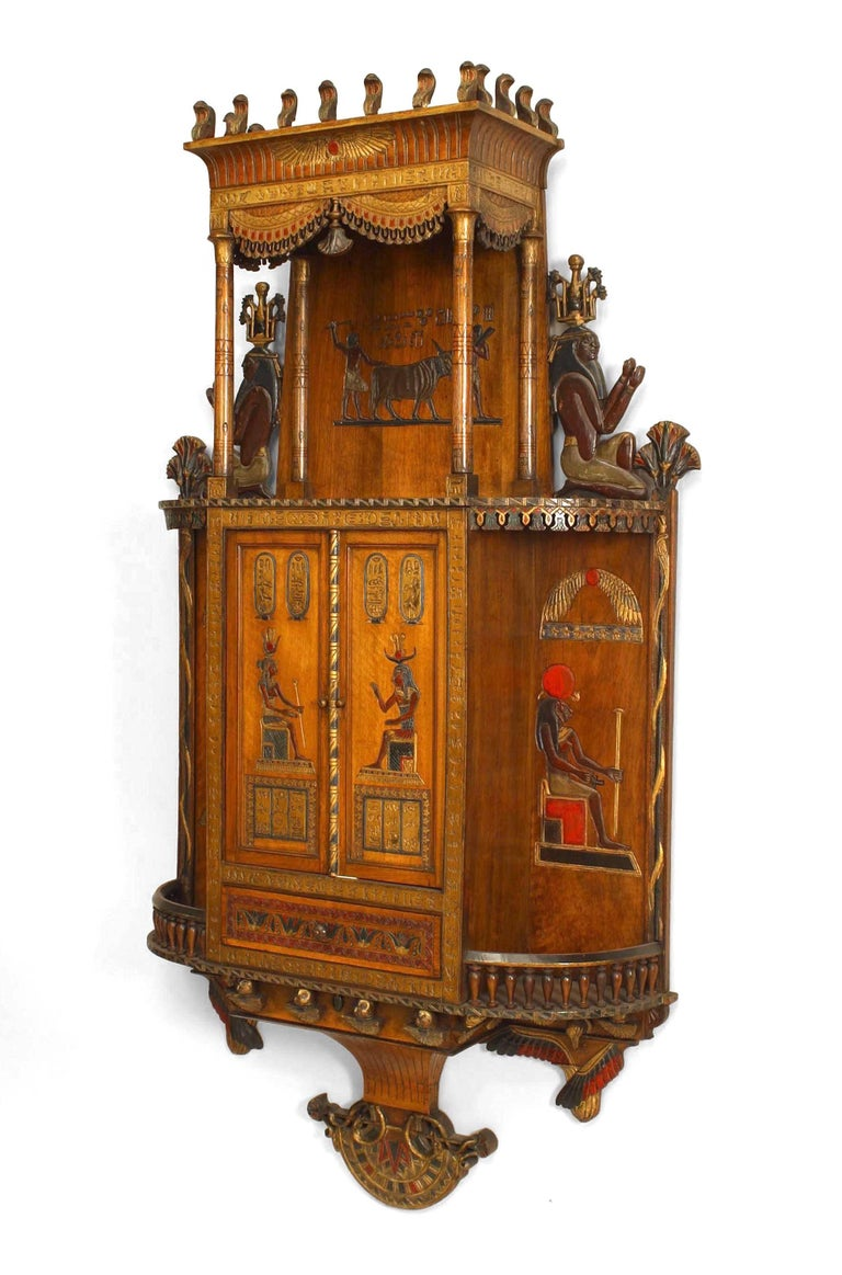 Egyptian Style Painted Hanging Wall Cabinet With Carved And Decorated Figures Two Front Doors Above