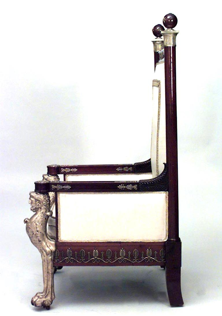 French Empire style '19th Century' mahogany throne chair with bronze doré figural front legs and trim with eggshell upholstery.