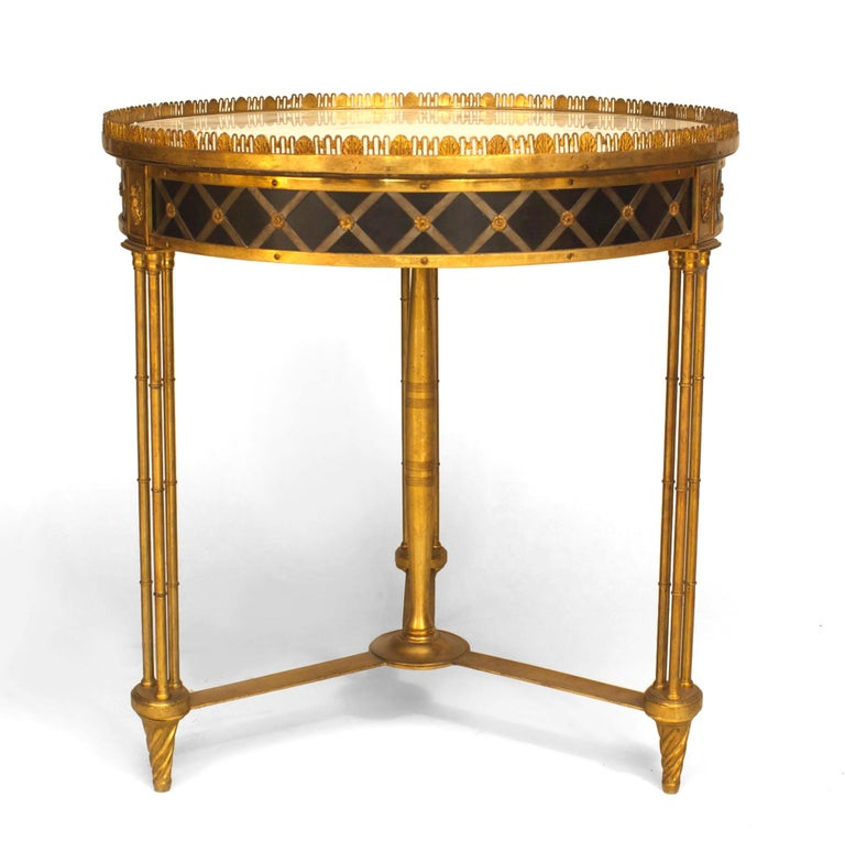 Twentieth century French Charles X style bronze dore gueridon end table with a round white marble top set within a filigree gallery above an x-design apron, three faux bamboo legs, and a finial stretcher.