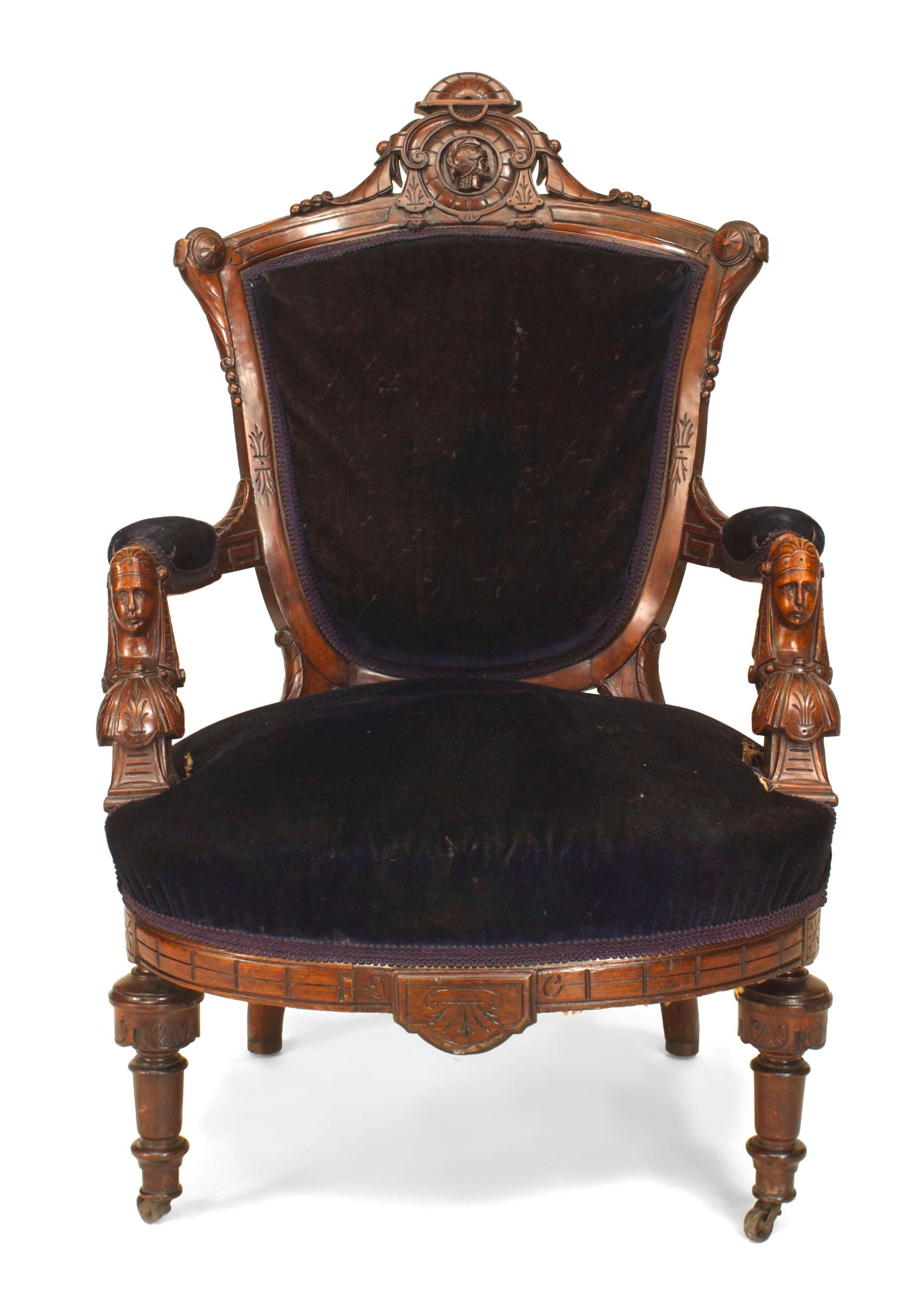American Victorian Eastlake Style (Renaissance Revival) Walnut Armchair  With Carved Heads And Blue Velvet