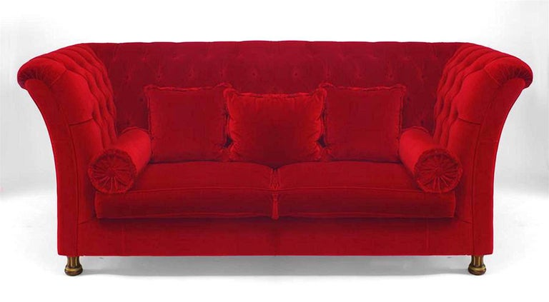 French Victorian style (modern) red tufted velvet settee with square back and side arms with two seat and bolster cushions and three loose back cushions standing on fluted gilt and walnut legs modern, contemporary.