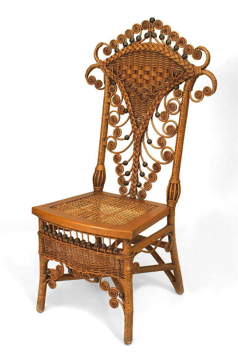 Set of four American Victorian natural wicker high back side chairs, each with a woven back, cane seat, and apron decorated with an overall scroll and ball trim design.
