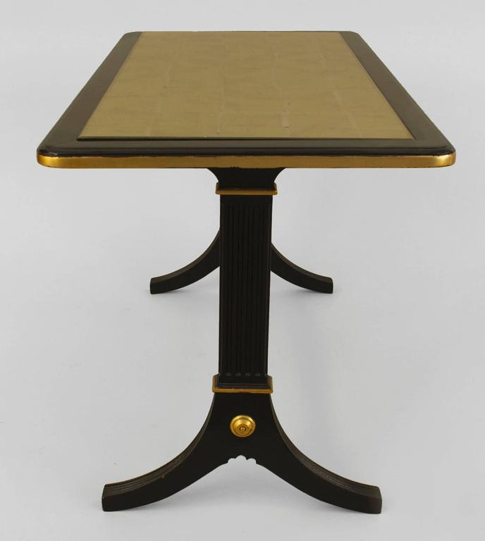 French 1940s ebonized and gilt trimmed rectangular coffee table with pedestal sides connected with a stretcher and supporting an inset gilt glass top (stamped: JANSEN).