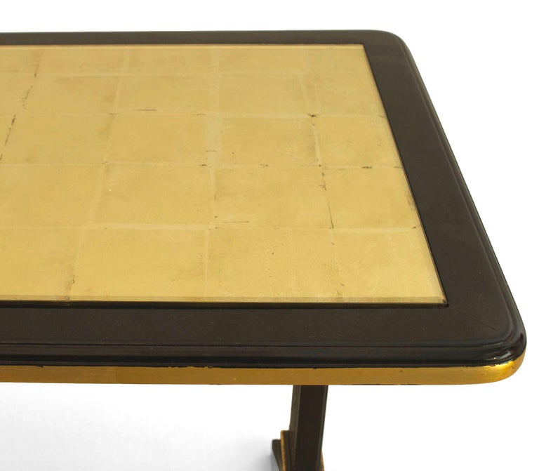 1940s French Gilt Glass and Ebonized Wood Coffee Table, by Jansen In Good Condition For Sale In New York, NY