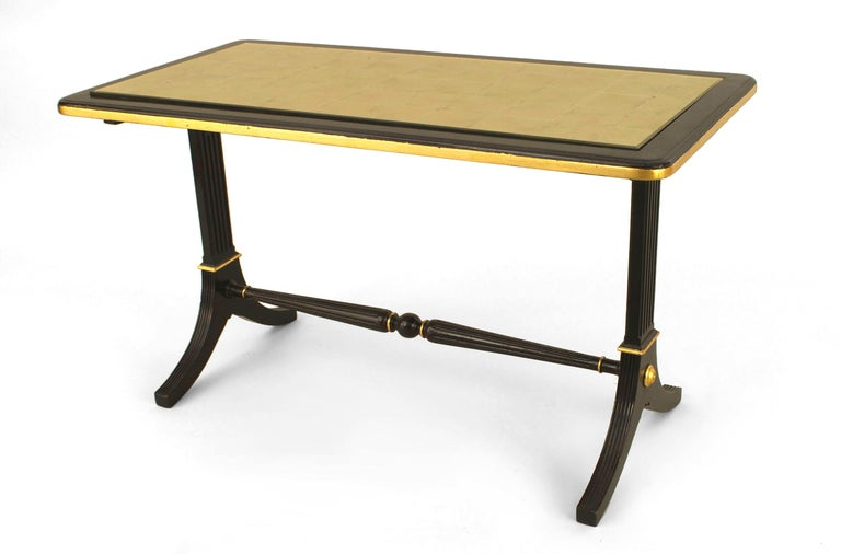 French 1940s ebonized and gilt trimmed rectangular coffee table with pedestal sides connected with a stretcher and supporting an inset gilt glass top (stamped: JANSEN).  Maison Jansen was aParis-basedinterior decorationoffice founded in 1880