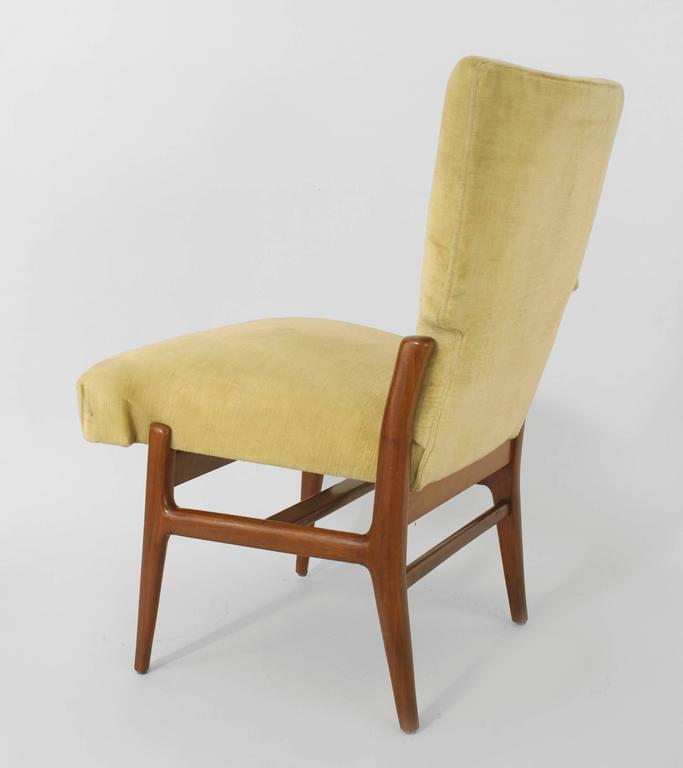 Set of eight Italian 1940s mahogany dining chairs with a geometric design having a button tufted light beige velvet upholstered back and seat with a stretcher. Measures: Two arms: 22.5