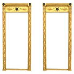 Pair of English Regency Gilt Mask and Lion Cornice Wall Mirrors