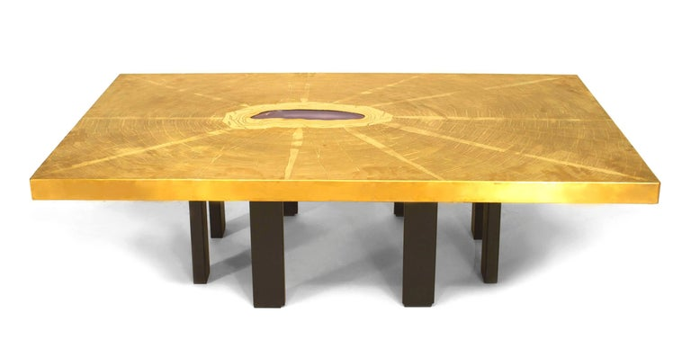 Dating to 1970's Belgium, this coffee table by Georges Mathias has a rectangular bronze top with an etched design radiating out from an inset agate center supported by a ring of rectangular ebonized legs.