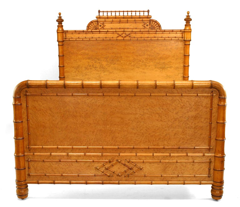 Victorian full sized bed composed of birds eye maple faux bamboo.  In addition to overall faux bamboo trim, the bed's headboard features side finials and a filigree pediment top.