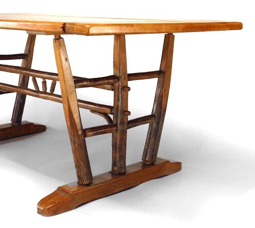 Rustic Old Hickory Dining Table With Rectangular Top On Trestle Supports  Joined By A Spindle Stretcher
