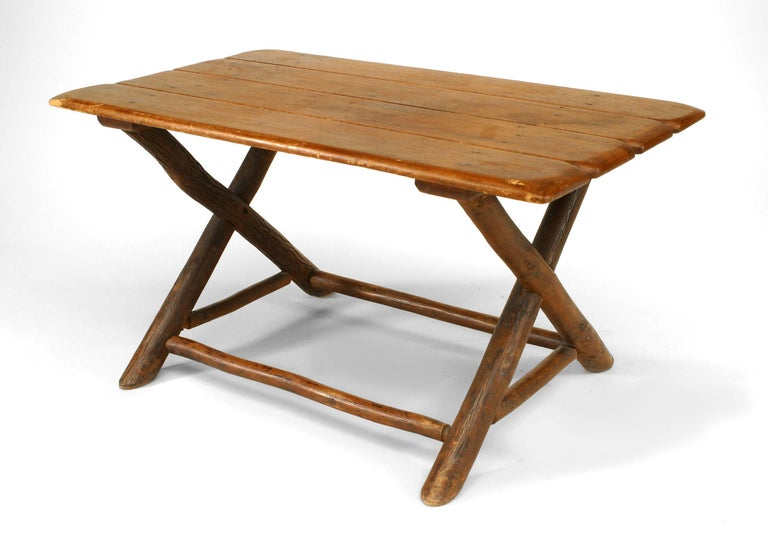 Rustic Old Hickory coffee table with rectangular plank top supported by a pair of cross leg bases connected with a box stretcher (signed: OLD HICKORY