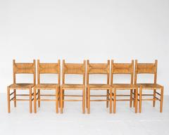 Rush Dining Chairs in the style of Charlotte Perriand