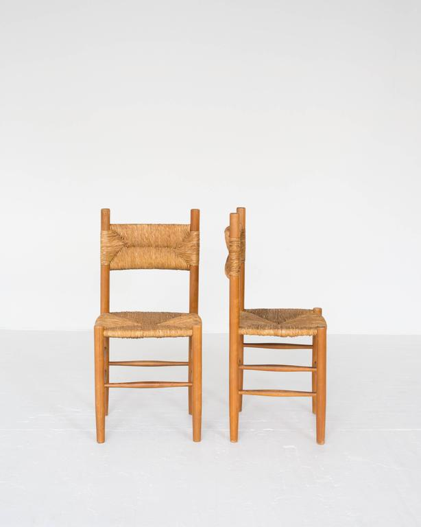 Mid-Century Modern Rush Dining Chairs in the Style of Charlotte Perriand For Sale