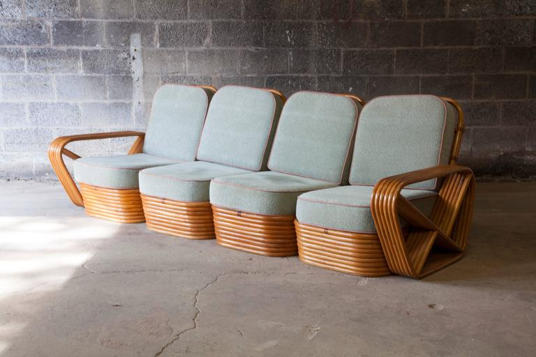 A rattan Paul Frankl style pretzel sofa. Sections are individual and can be separated. Original upholstery.