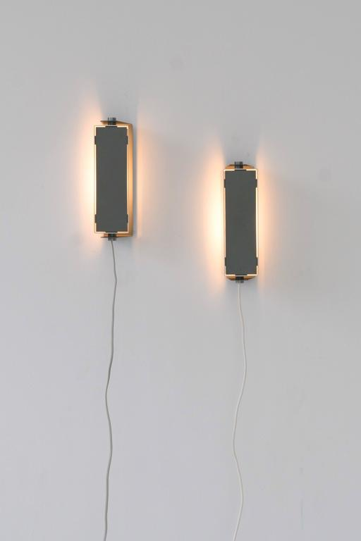 Rare Jo Hammerborg rotating lacquered metal and brushed aluminium wall sconces.