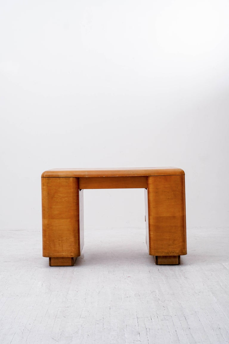 Paul Goldman 1940s desk in maple. Uncomplicated form with functional storage.