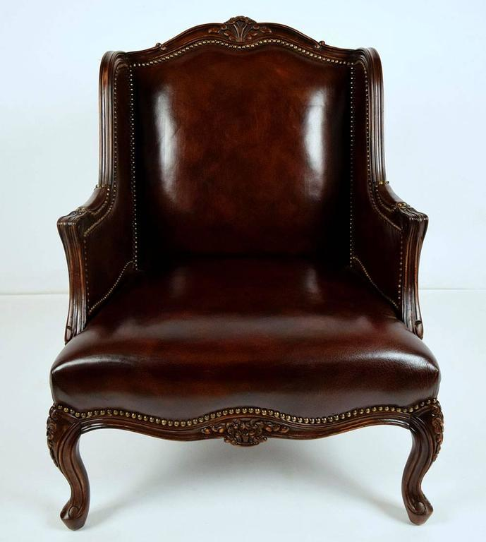 This 1970s Louis XV Style Wing Back Chair And Ottoman Set Features Leather  Upholstery And