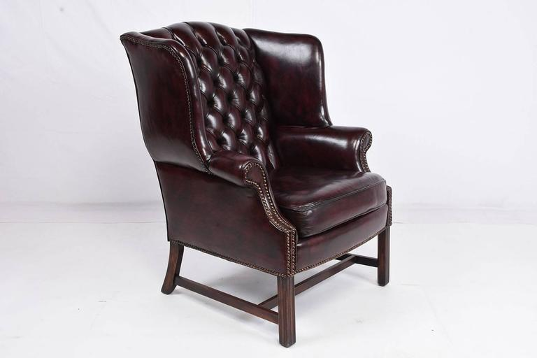 Chesterfield Tufted Leather Wing Back Chair And Ottoman