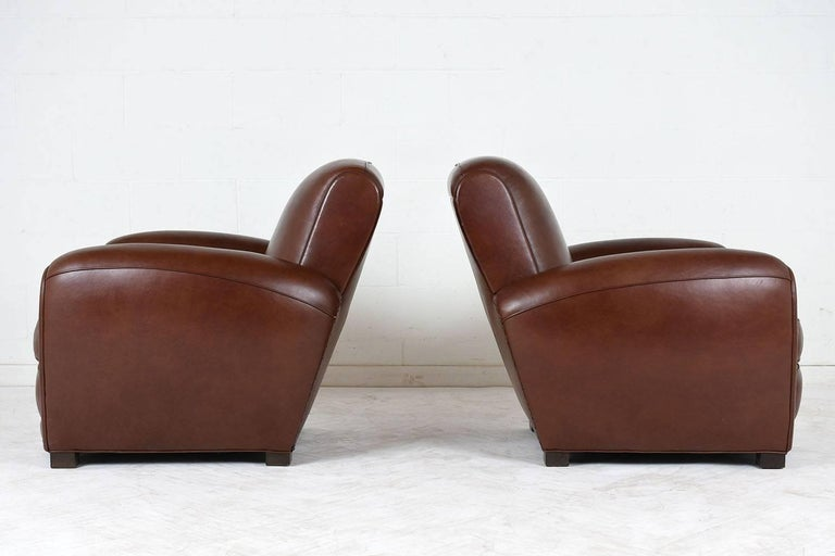 Patinated Pair of French Art Deco-style Leather Club Chairs For Sale
