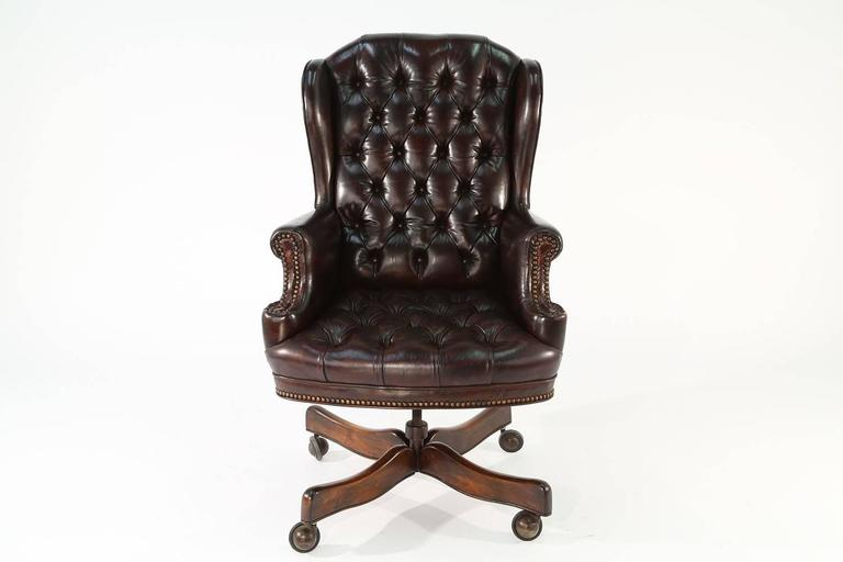 This 1960s Regency-style office chair features leather upholstery and a wood base. The & Vintage Regency-Style Leather Office Chair For Sale at 1stdibs