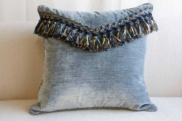 This pair of Queen Anne-style pillows are made from crushed blue velvet with fabric tassel details. The tassels are made from different shades of blue and yellow and make a great accent for the pillows. Inside there is a comfortable down pillow