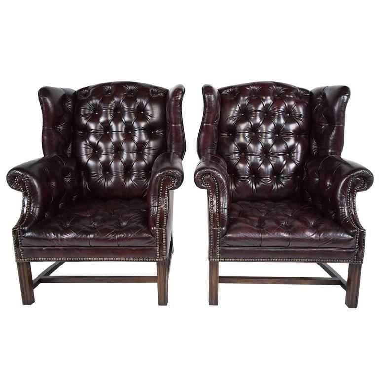 This 1950s Vintage Pair Of Regency Style Chesterfield Wingback Chairs  Feature Their Original Leather Upholstery