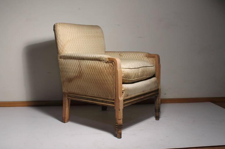 Completely period club chair. Either French or American deco. In the style Kem Weber, Gilbert Rohde, Walter Von Nessen  Has beautiful hardware details. ribbed on the side and front. Front legs have concentric metal rings on the feet with metal