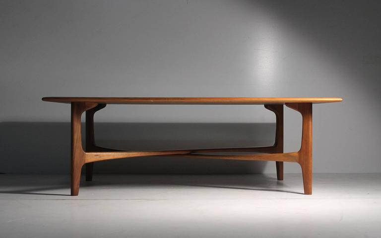 Wonderful rectangular coffee table with just a gorgeous wood grain and desirable X-stretcher. Signed underside by DUX. Vintage original condition to finish. Some mild wear. Scratches and a couple very subtle water rings. Photos available upon