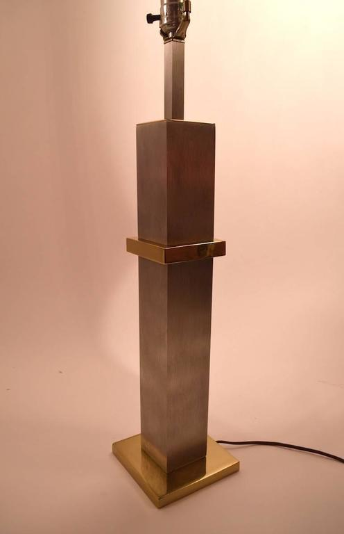 Pair of squared brushed finish steel and brass plate table lamps manufactured by Laurel. Great cityscape style design, working, clean original condition. Height to top of socket measures 27.5