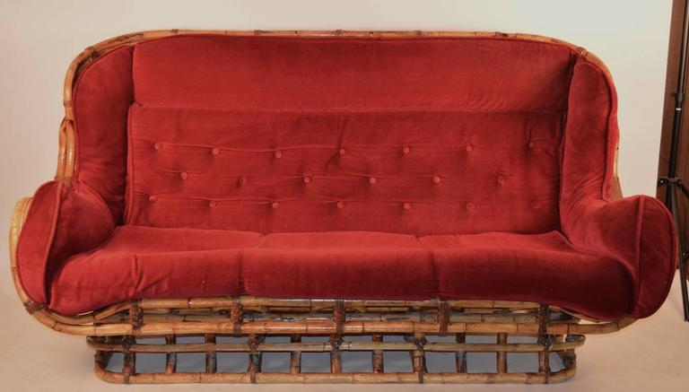 Unusual form bamboo sofa comes with upholstered fitted, tufted pad and pad as is. Well-made sturdy frame, stylish lines, comfortable and chic. Please view the matching chairs and ottoman we have listed from this same set.