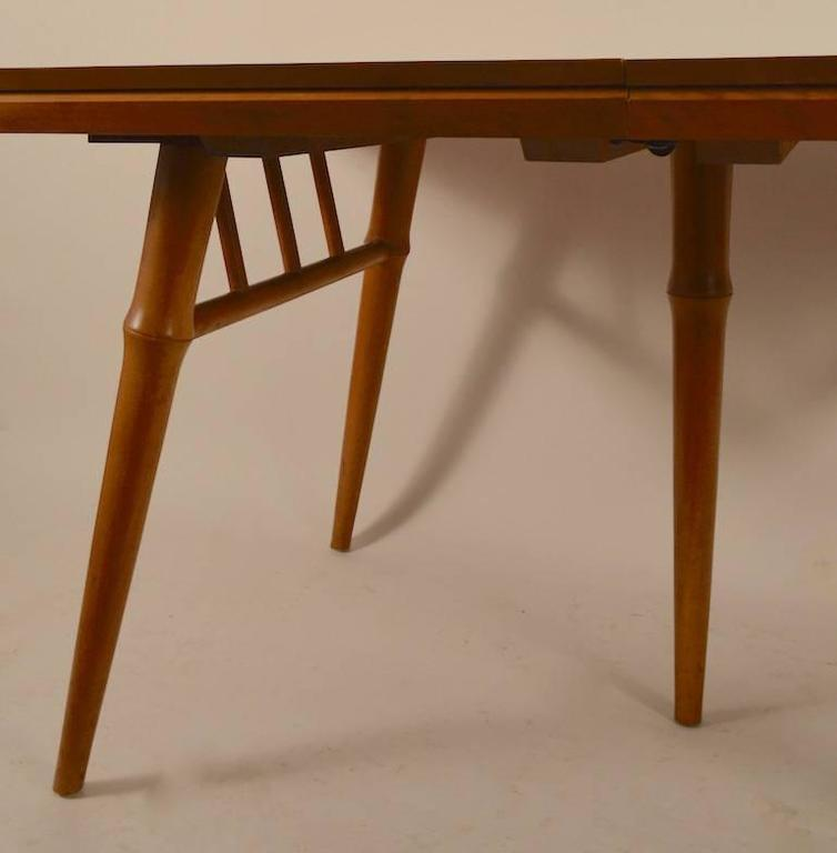 Large dining table designed by Russel Wright for Conant Ball Furniture. This Classic table comes with three large (13.25