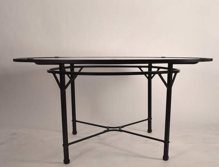 Brown Jordan Venetian pattern umbrella dining table. We have two tables available, one does not include the glass top. Price in listing is for the table including the glass. Table without glass $675, suitable for indoor, or outdoor use.   Please